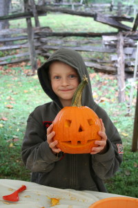 Owens child with pumpkin 1